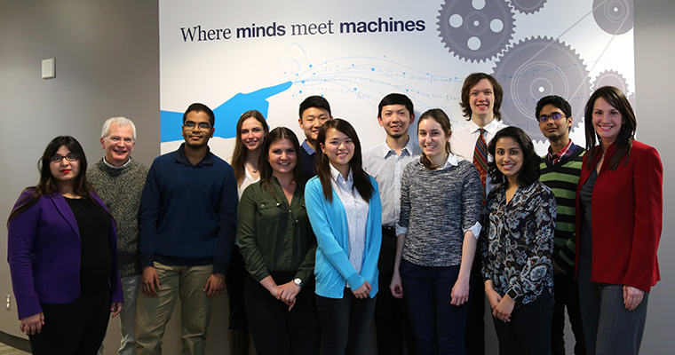 Alumna Marisa Sterling (far right), faculty and members of the Ontario Professional Engineers Foundation for Education pose with undergraduate scholarship recipients in the Bahen Centre for Information Technology. (Photo: Jamie Hunter)