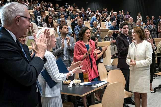 Dean Cristina Amon (right) receives a standing ovation after her speech at the Celebration of Leadership event on Wednesday, June 26, 2019. (credit: Lisa Sakulensky)