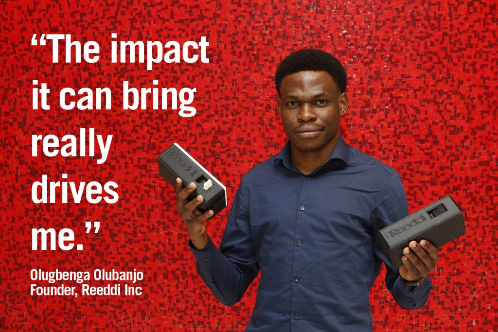 """Photo of Olugbenga Olubanjo holding two Reeddi Capsules, with quote """"The impact it can bring really drives me."""""""