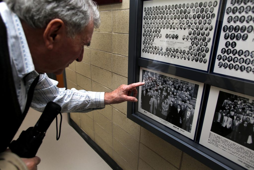 Barry Hitchcock looks at his Civil Engineering class photo of 5T8 .