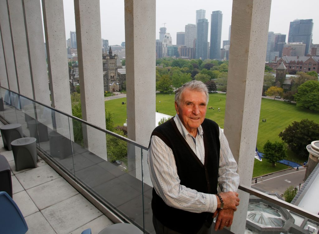 Barry Hitchcock (Civ 5T8) poses for a photo overlooking the University of Toronto's downtown campus from the new Myhal Centre.