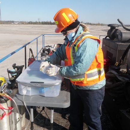 Professor Lesley Warren performs environmental sampling at Syncrude Canada's Base Mine Lake, an important location for mining-impact water research and technology development in Alberta's Oil Sands. (Photo courtesy Lesley Warren)